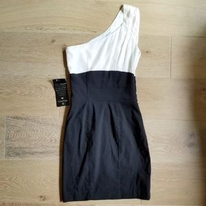 NWT Bebe one shoulder black and white dress.